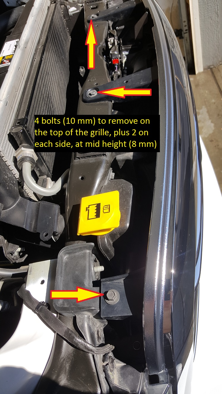 Now pull each side of the bottom of the grille in order to release the clips they are tight but you need to pull them straight toward you while standing